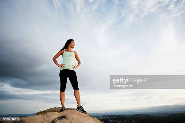vietnamese woman standing on rocky hilltop - hand on hip stock pictures, royalty-free photos & images