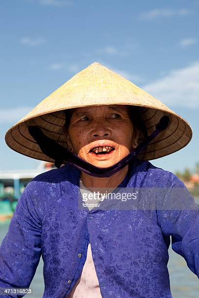 vietnamese woman with traditional clothing driving a taxi boat, vietnam - very ugly women stock photos and pictures