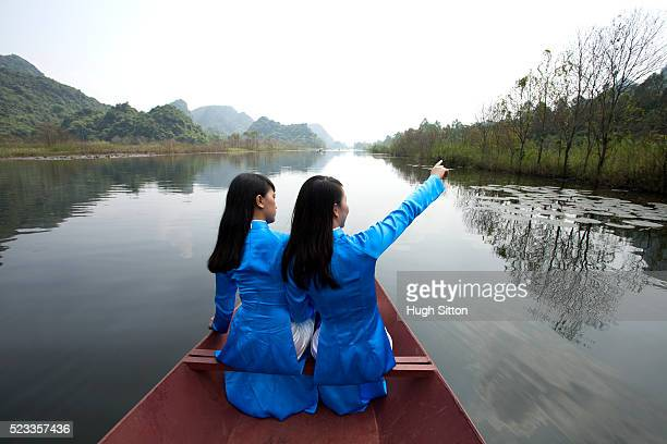 vietnamese women at the perfume pagoda. hanoi. vietnam - hugh sitton stock pictures, royalty-free photos & images