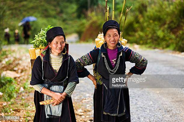 Vietnamese women carrying corn near Sapa town