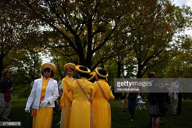 Vietnamese women dressed in traditional clothing attend a ceremony commemorating the 40th anniversary of the fall of Saigon near the Vietnam Veterans...
