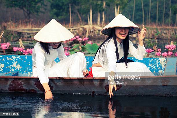 vietnamese women in traditional costume - hugh sitton stock pictures, royalty-free photos & images