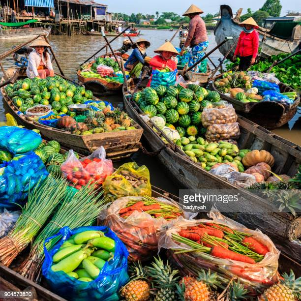 vietnamese women selling fruits on floating market, mekong river delta, vietnam - floating market stock photos and pictures