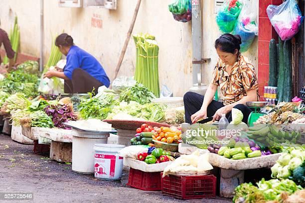 Vietnamese women selling vegetables on Hanoi street