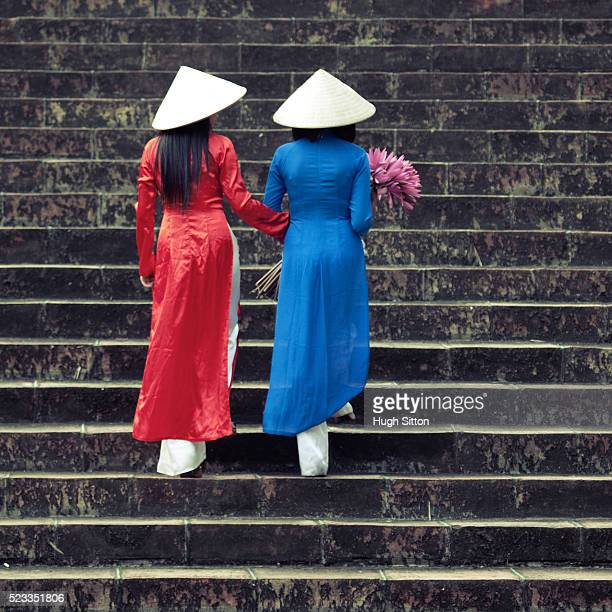 vietnamese women wearing traditional costume - hugh sitton stock pictures, royalty-free photos & images