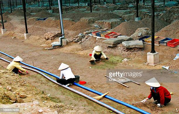 Vietnamese workers at an excavation site inside the Thang Long Imperial Citadel