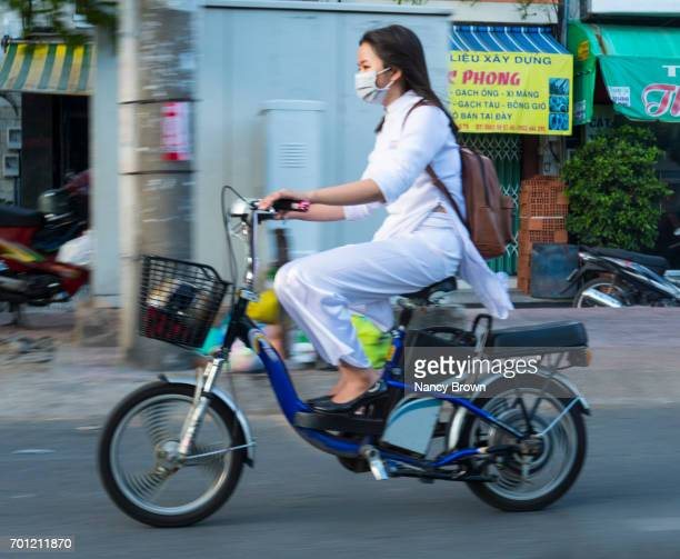 Vietnamese Young Woman on Scooter in Ho Chi Minh City in Vietnam.