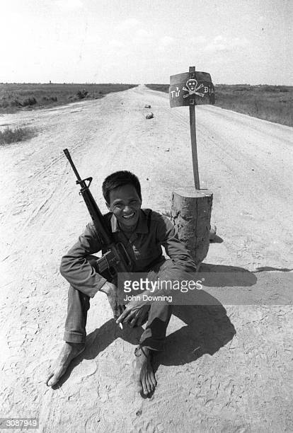 Vietnamese youth with a rifle during the Vietnam War