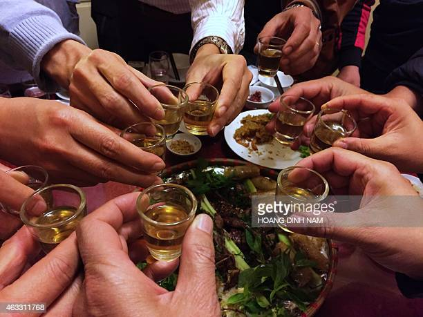 VietnamhealthsocialalcoholFEATURE by Cat Barton In this picture taken on January 17 men toast with rice wine during a party at a restaurant in in...