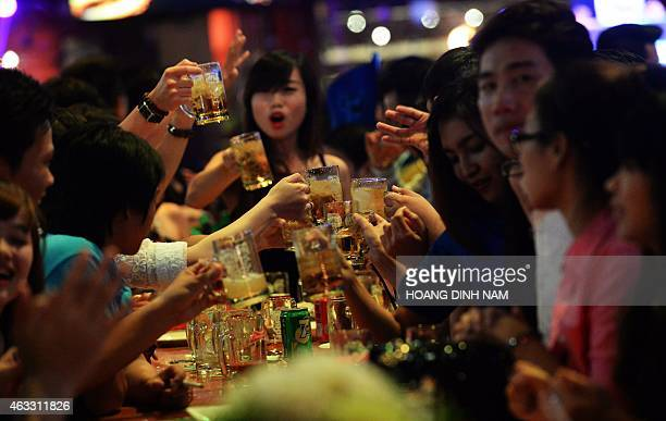 VietnamhealthsocialalcoholFEATURE by Cat Barton This picture taken on December 13 2014 shows youngsters cheering up while drinking beer at a local...