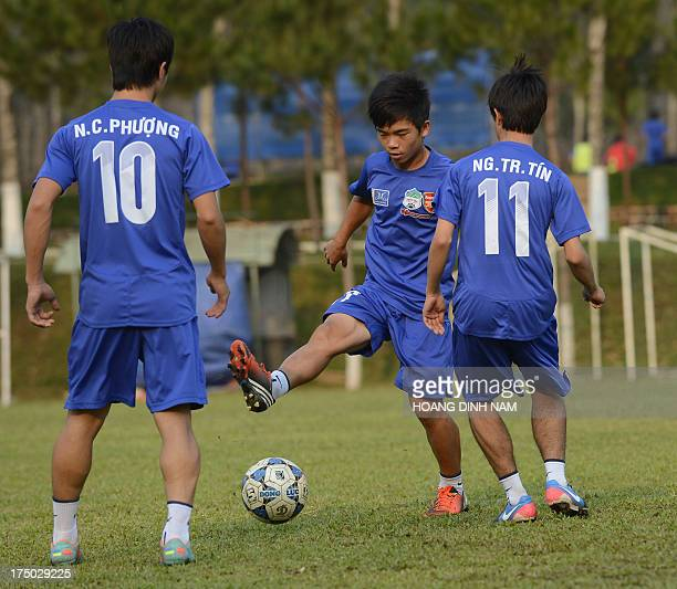 VietnamlifestylesportArsenalfblFEATURE by Tran Thi Minh Ha This picture taken on March 11 2013 shows student players from HAGL Arsenal JMG Football...