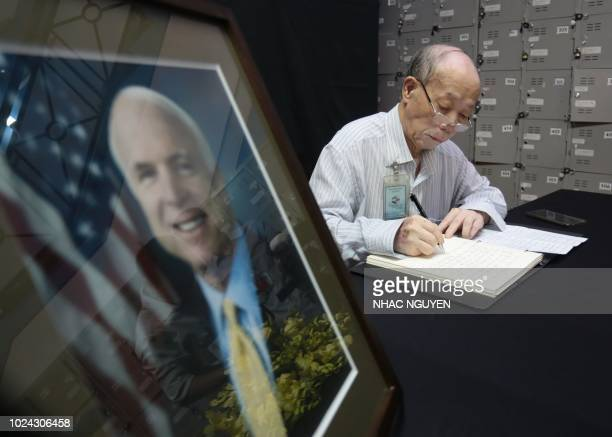 Vietnam's 81yearold war veteran Pham Minh Chuc extends his a condolence to late US Senator John McCain during a memorial tribute at the US embassy in...