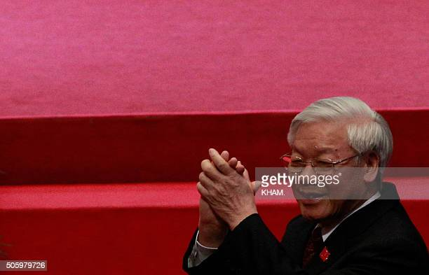 Vietnam's Communist Party General Secretary Nguyen Phu Trong greets delegates upon his arrival for the opening ceremony of the 12th National Congress...