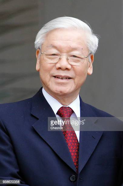 Vietnam's Communist Party General Secretary Nguyen Phu Trong poses prior to his meeting with French President Emmanuel Macron at the Elysee Palace on...