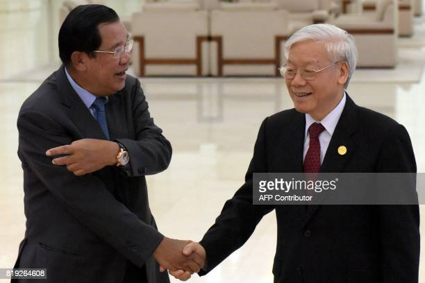 Vietnam's Communist Party Secretary General Nguyen Phu Trong shakes hands with Cambodian Prime Minister Hun Sen upon arrival at the Peace Palace in...