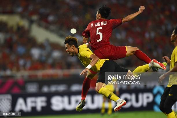 Vietnam's defender Doan Van Hau fights for the ball with Malaysia's defender Mohamad Aidil Zafuan Adb Radzak during the 2018 AFF Suzuki Cup match...