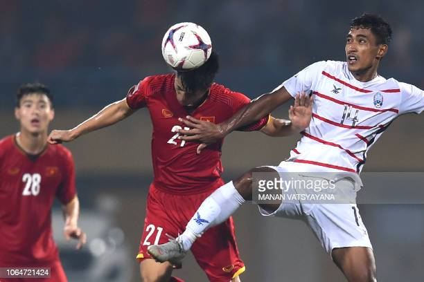 Vietnam's defender Tran Dinh Trong fights for the ball with Cambodia's forward Reung Bunheing during the AFF Suzuki Cup 2018 football match between...