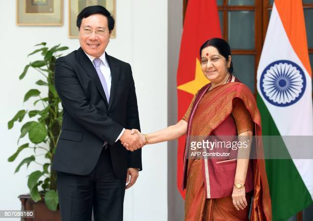Vietnam's Deputy Prime Minister and Minister of Foreign Affairs Pham Binh Minh and Indian External Affairs Minister Sushma Swaraj shake hands ahead...