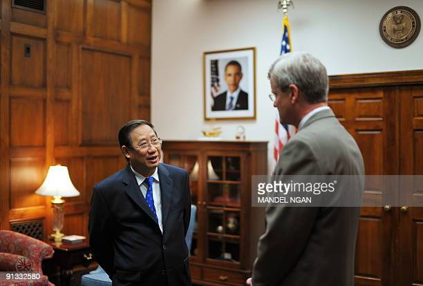 Vietnam�s Deputy Prime Minister Pham Gia Khiem chats with Stephen P Jacobs Deputy Assistant Secretary of Commerce for Market Access and Compliance...