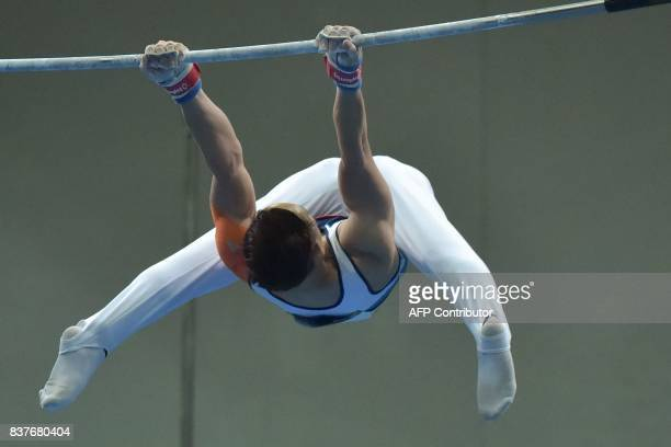 Vietnam's Dinh Phuong Thanh competes in the men's artistic gymnastics horizontal bars final event of the 29th Southeast Asian Games in Kuala Lumpur...