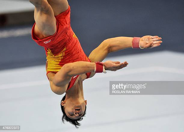 Vietnam's Dinh Phuong Thanh performs on the floor during the men's individual allaround final at the 28th Southeast Asian Games in Singapore on June...