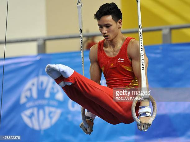 Vietnam's Dinh Phuong Thanh performs on the rings during the men's individual allaround final at the 28th Southeast Asian Games in Singapore on June...