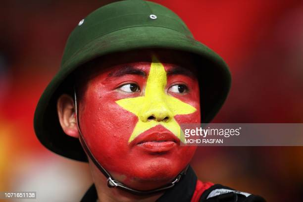 Vietnam's fan arrives to watch the first leg of the AFF Suzuki Cup 2018 final football match between Malaysia and Vietnam at the Bukit Jalil National...
