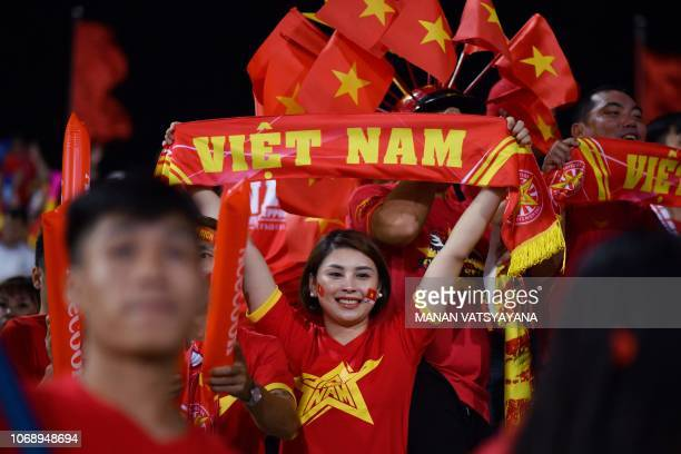 Vietnam's fans cheer before the start of the second leg of the AFF Suzuki Cup 2018 semifinal football match between Vietnam and the Philippines at...
