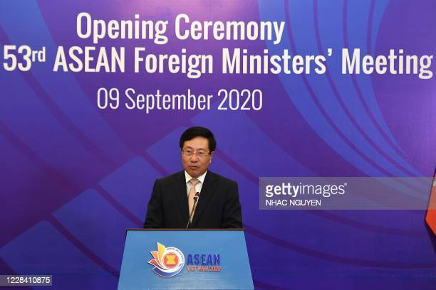 Vietnam's Foreign Minister Pham Binh Minh addresses a live video conference during the opening ceremony of the 53rd Association of Southeast Asian...