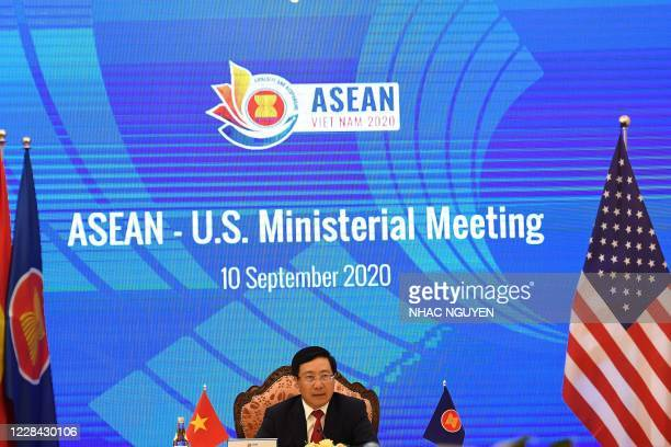 Vietnam's Foreign Minister Pham Binh Minh addresses a live video conference during the Association of Southeast Asian Nations -US Ministerial...