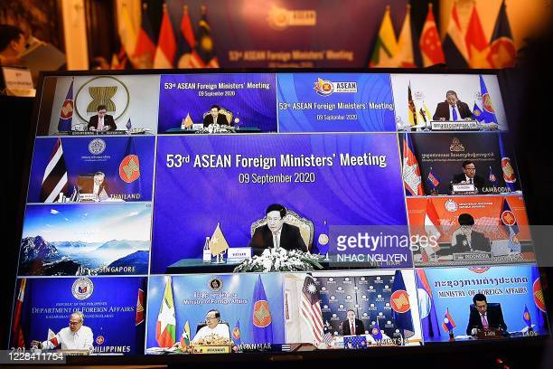 Vietnam's Foreign Minister Pham Binh Minh and Foreign ministers from ASEAN countries are seen on a television screen during the 53rd Association of...