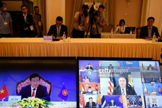 Vietnam's Foreign Minister Pham Binh Minh and US Secretary of State Mike Pompeo are seen on monitor screens during the Association of Southeast Asian...