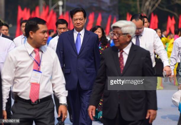 Vietnam's former prime minister Nguyen Tan Dung arrives to attend a ceremony marking the 50th anniversary of the Tet Offensive in Ho Chi Minh City on...