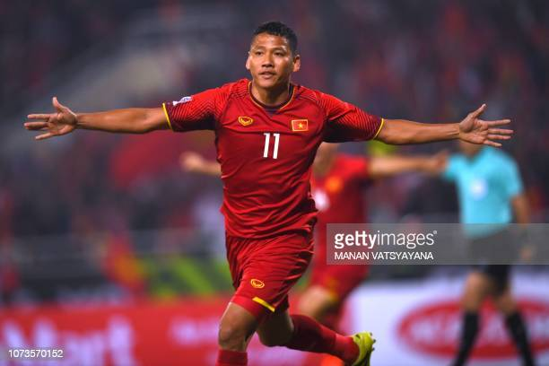 Vietnam's forward Nguyen Anh Duc celebrates after making the first goal for Vietnam during the AFF Suzuki Cup 2018 final football match between...