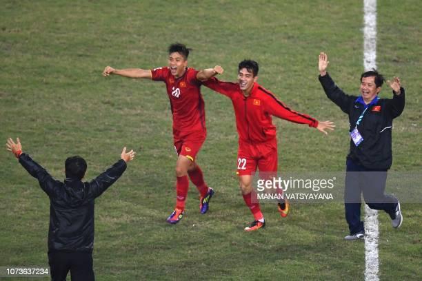 Vietnam's forward Phan Van Duc and forward Nguyen Tien Linh celebrate after winning the AFF Suzuki Cup 2018 final football match between Vietnam and...