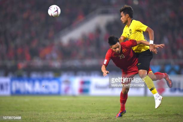 Vietnam's forward Phan Van Duc and Malaysia's defender Aidil Zafuan fight for the ball during the AFF Suzuki Cup 2018 final football match between...