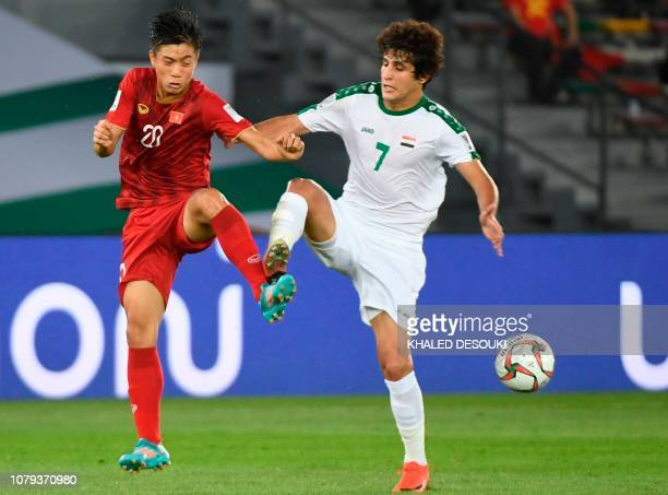 Vietnam's forward Van Duc Phan fights for the ball with Iraq's midfielder Safaa Hadi AlFuraiji during the 2019 AFC Asian Cup group D football match...