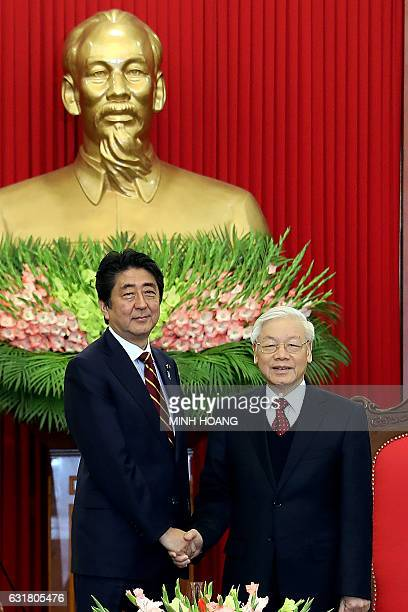 Vietnam's General Secretary Nguyen Phu Trong shakes hands with Japan's Prime Minister Shinzo Abe at the office of the CPV Central Committee in Hanoi...