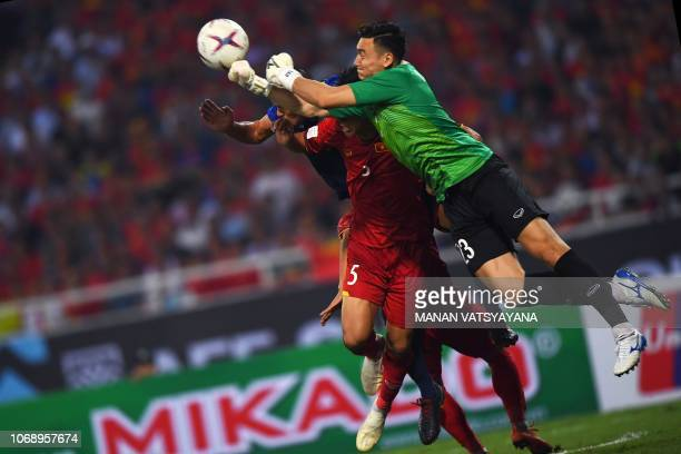 Vietnam's goalkeeper Dang Van Lam punches the ball during the second leg of the AFF Suzuki Cup 2018 semifinal football match between Vietnam and the...