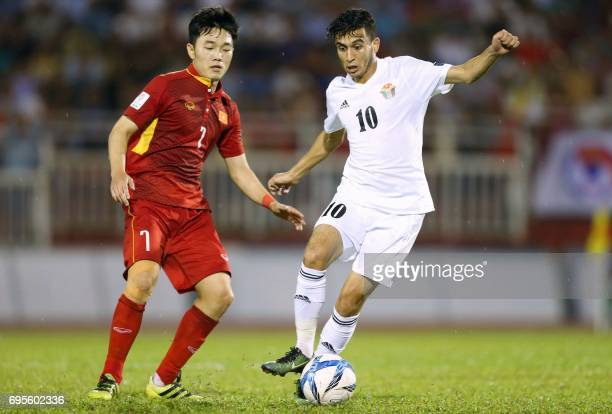 Vietnam's Luong Xuan Truong fights for the ball with Jordan's Ahmad Saleh during a qualifying match between Jordan and Vietnam for the 2019 AFC Asian...
