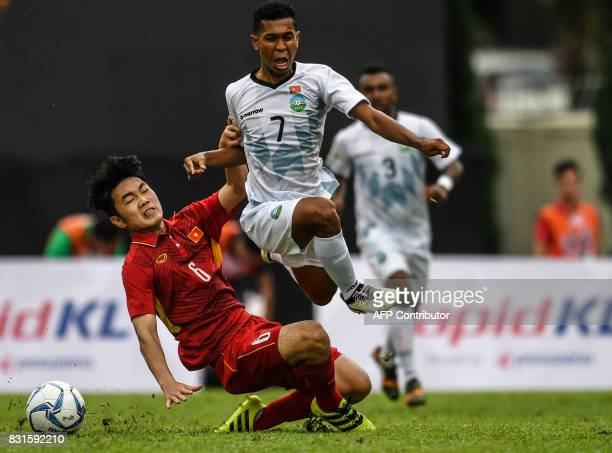 Vietnam's Luong Xuan Truong fights the ball with East Timor's Rufino Walter Gama during their men's football Group B round match at the 29th...