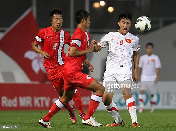 Vietnam's Mac Hong Quan competes for the the ball with Hong Kong's Chak Ting Fung during their 2015 AFC Asian Cup qualifier football match in Hong...