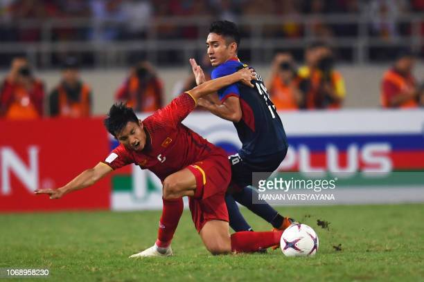 Vietnam's midfielder Doan Van Hau and Philippines' forward Patrick Reichelt fight for the ball during the second leg of the AFF Suzuki Cup 2018...