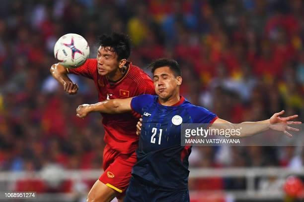 Vietnam's midfielder Doan Van Hau fights for the ball with Philippines' midfielder Martin Steuble during the second leg of the AFF Suzuki Cup 2018...