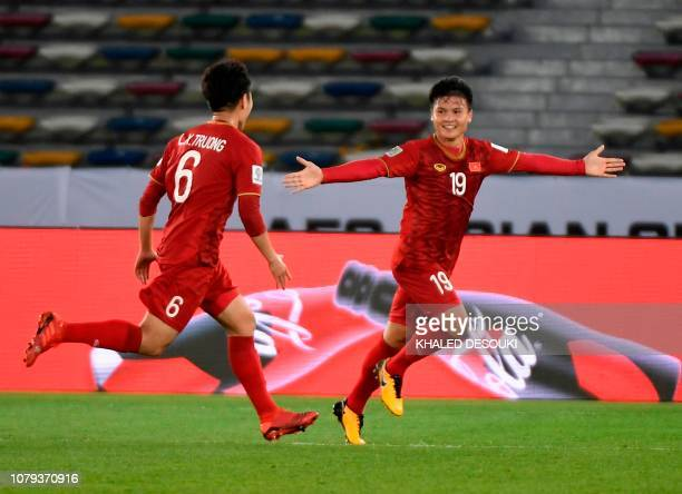 Vietnam's midfielder Quang Hai Nguyen and Vietnam's midfielder Xuan Truong Luong celebrate after scoring a goal during the 2019 AFC Asian Cup group D...