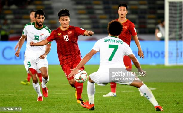 Vietnam's midfielder Quang Hai Nguyen fights for the ball with Iraq's midfielder Safaa Hadi AlFuraiji during the 2019 AFC Asian Cup group D football...