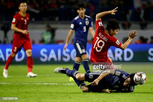 Vietnam's midfielder Quang Hai Nguyen vies for the ball with Vietnam's midfielder Xuan Truong Luong during the 2019 AFC Asian Cup quarterfinal...
