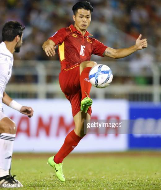 Vietnam's Nguyen Cong Phuong controls the ball next to Jordan's Tareq Khattab during a qualifying match between Jordan and Vietnam for the 2019 AFC...