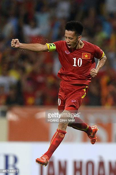 Vietnam's Nguyen Van Quyet celebrates after he scored a goal against Manchester City during a friendly football match between Manchester City and...