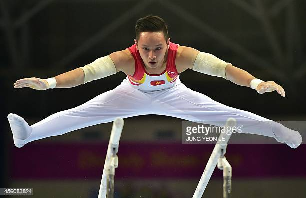 Vietnam's Phuong Thanh Dinh performs in the men's parallel bars final of the artistic gymnastics event during the 2014 Asian Games at the Namdong...